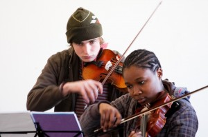 Violinists Martijn Wildervanck and Lebogang Ledwaba rehearsing some Tchaikovsky