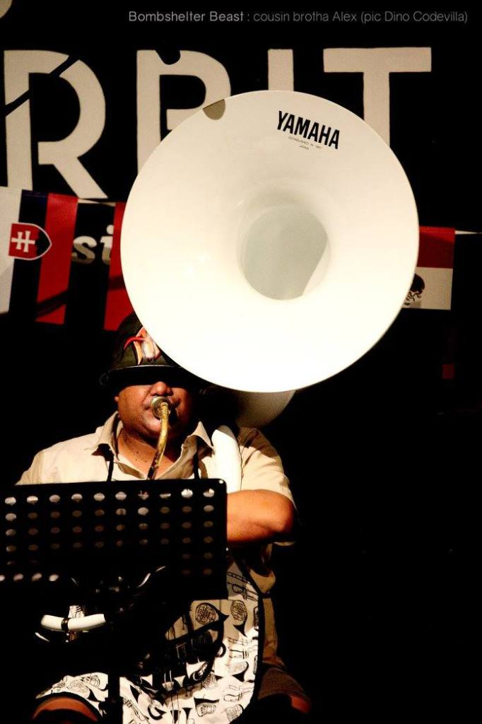 Alex Hitzeroth with his sousaphone, Suzy performing at The Orbit with Bombshelter Beast.